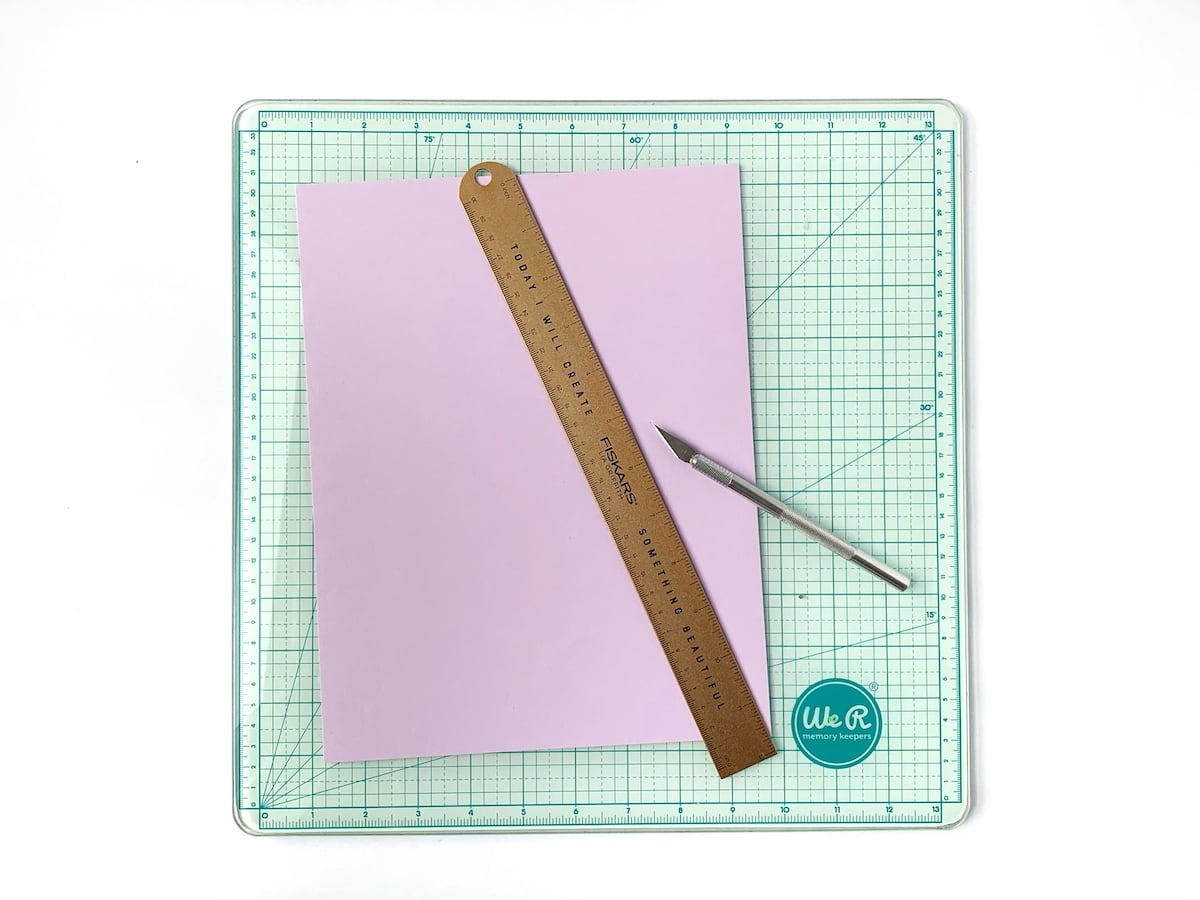 grapesicle paper, ruler, and craft knife on cutting board