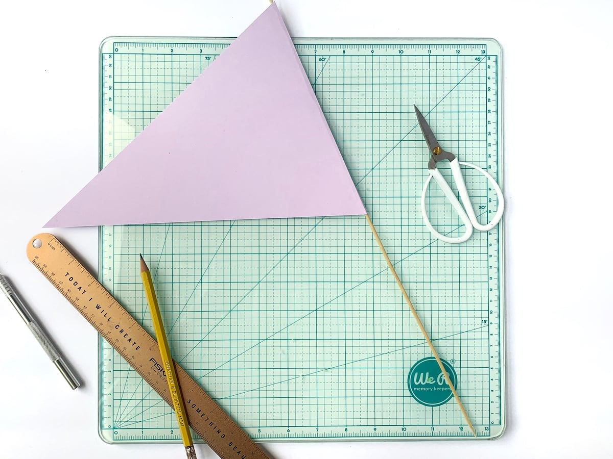 adding pennant to wooden skewer