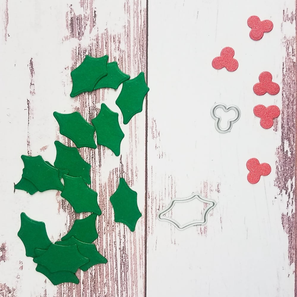 die cut holly pieces from lockwood green and red wagon sparkle