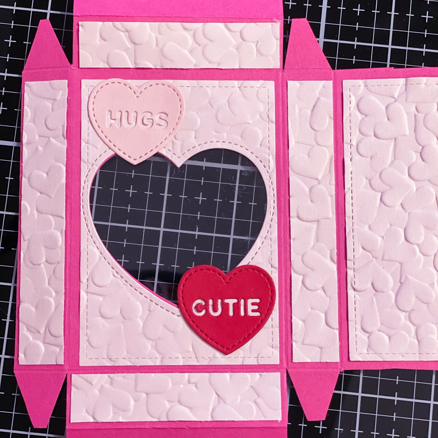 embossed heart paper attached to heart candy valentine's day boxes