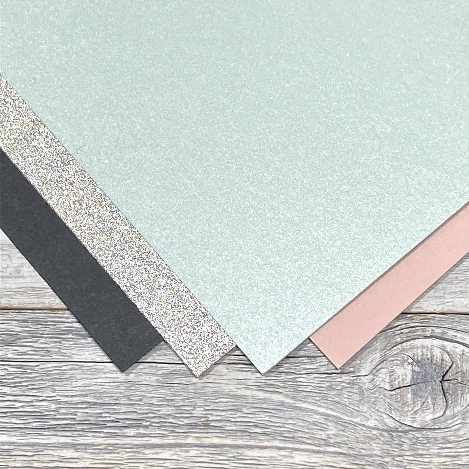 slate, silver sparkle, aquamarine, and nude papers