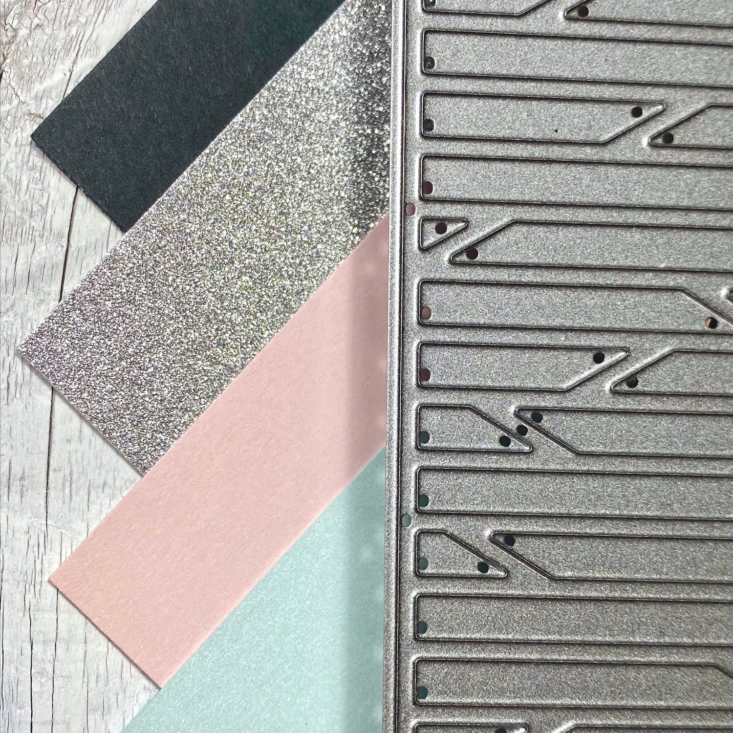 slate, silver mirrisparkle, nude, and aquamarine papers with background die