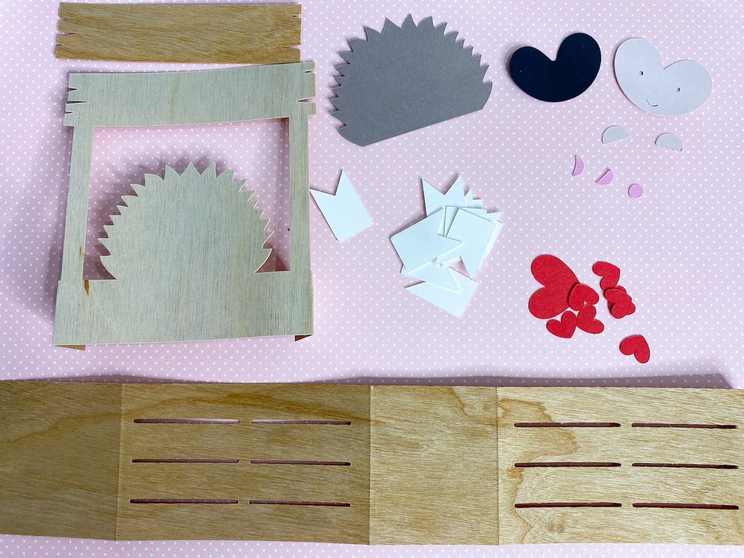 Die cut pieces for Hedgehog kissing booth pop-up card