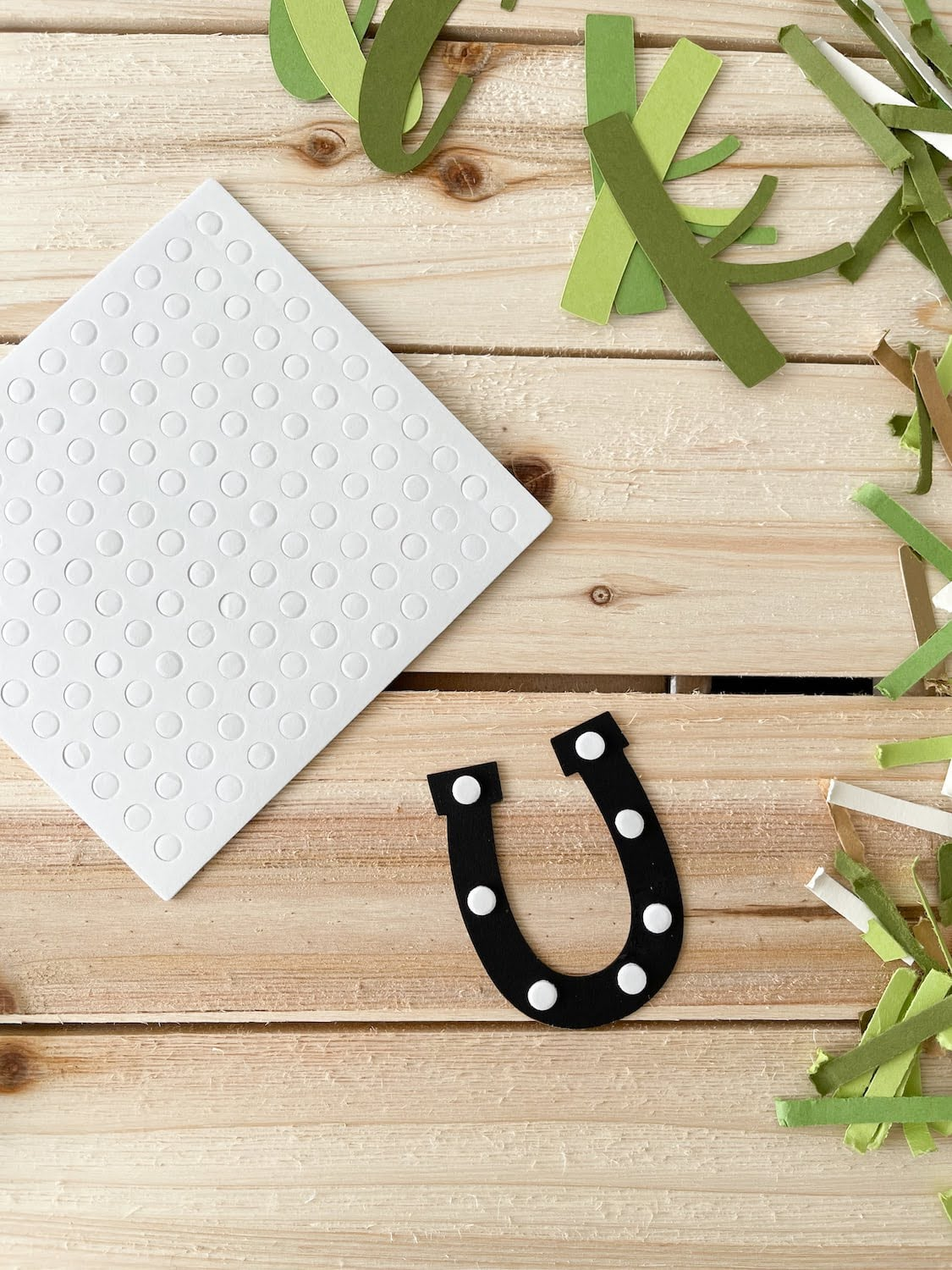 layering horseshoe die cut for St. Patrick's Day Luck Card