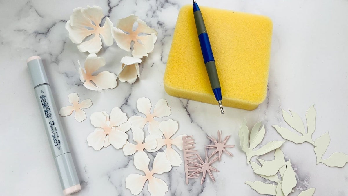 curling die cut flowers with stylus tool and coloring with copic marker