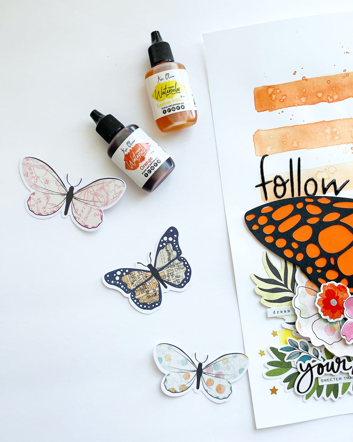 Adding watercolors to the background of butterfly scrapbook layout