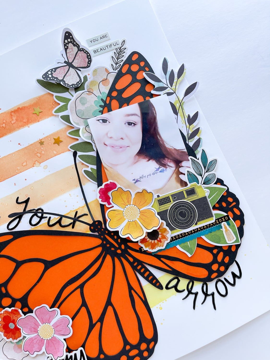 photo and embellishments on monarch butterfly layout