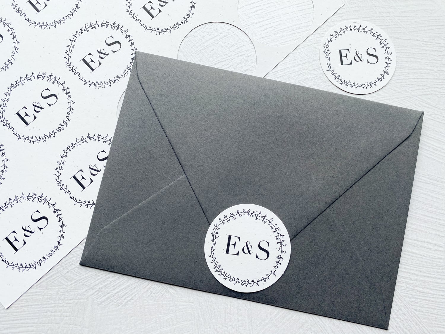 circle monogram attached to envelope flap