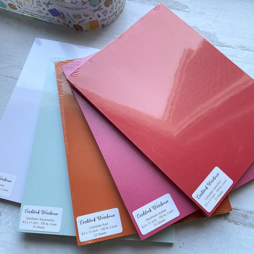 packs of cardstock warehouse paper fanned out for packing