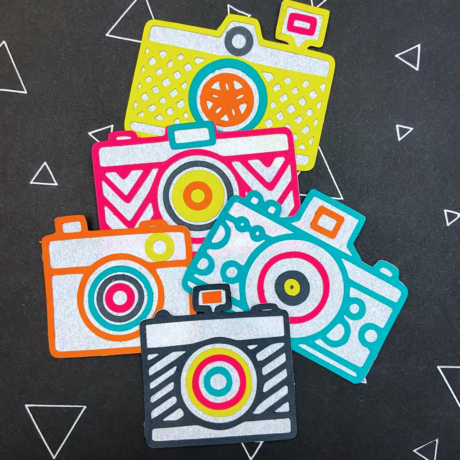 die cut camera in Chartreuse, Hot Pink, Rust, Marrs, and Slate