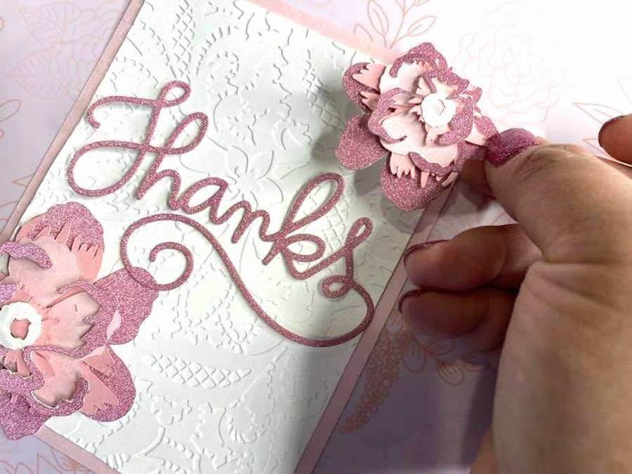 Attaching flower to pink glitter thank you card