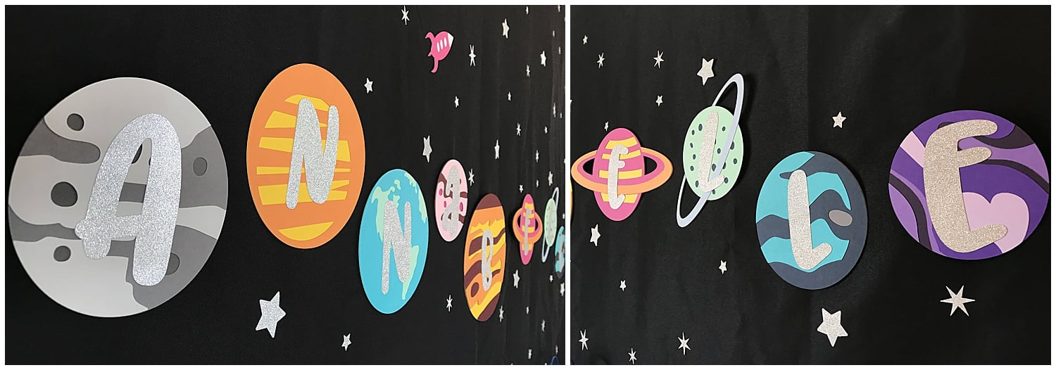 planet party banner hung on a black sheet