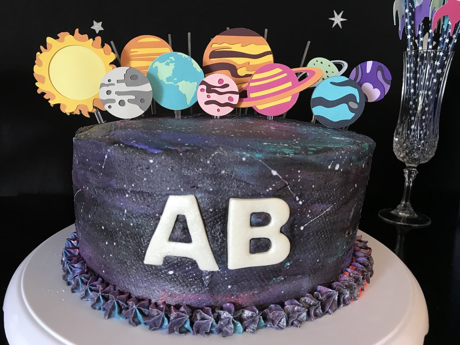 paper planet toppers in galaxy cake