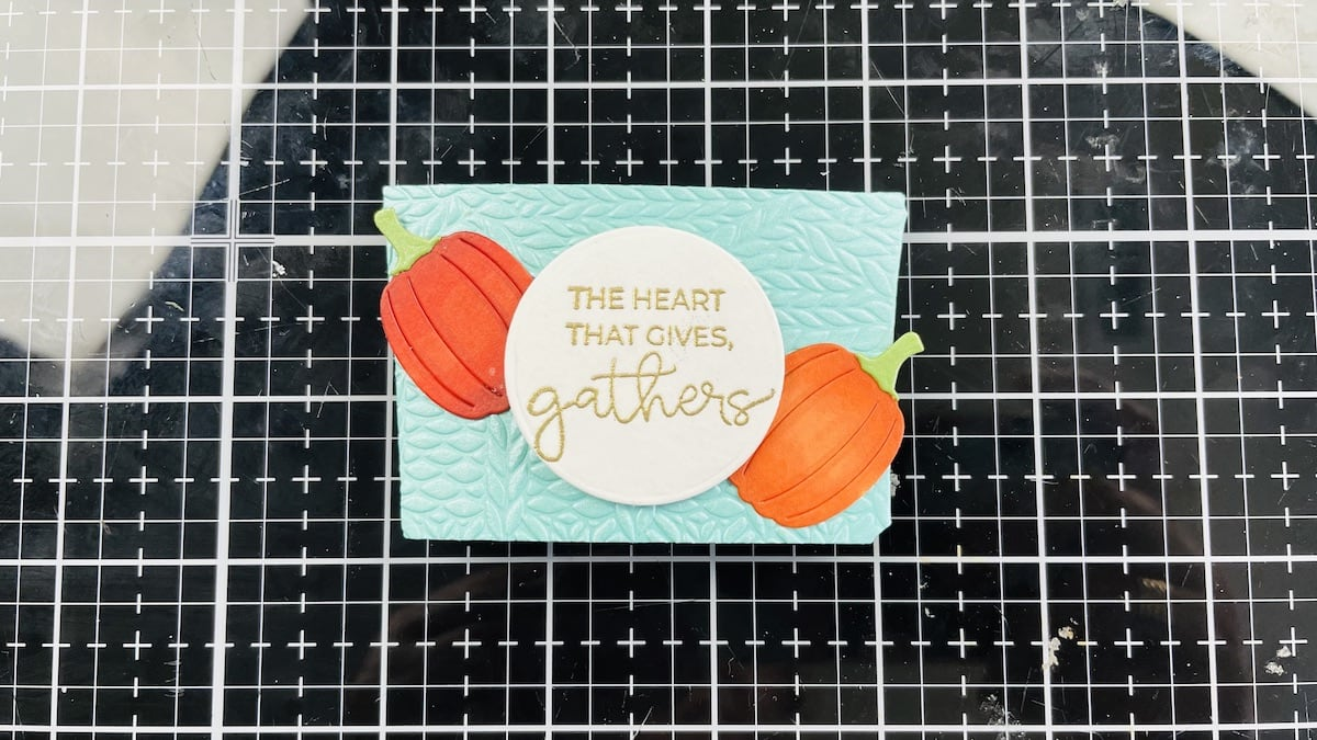 embossed sentiment and pumpkins glued to band