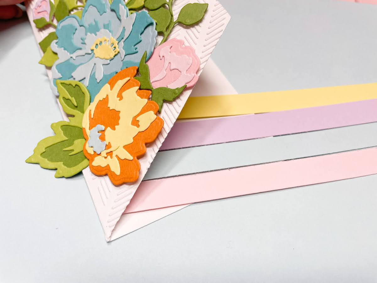 adding strips to the diagonal section cut off the card