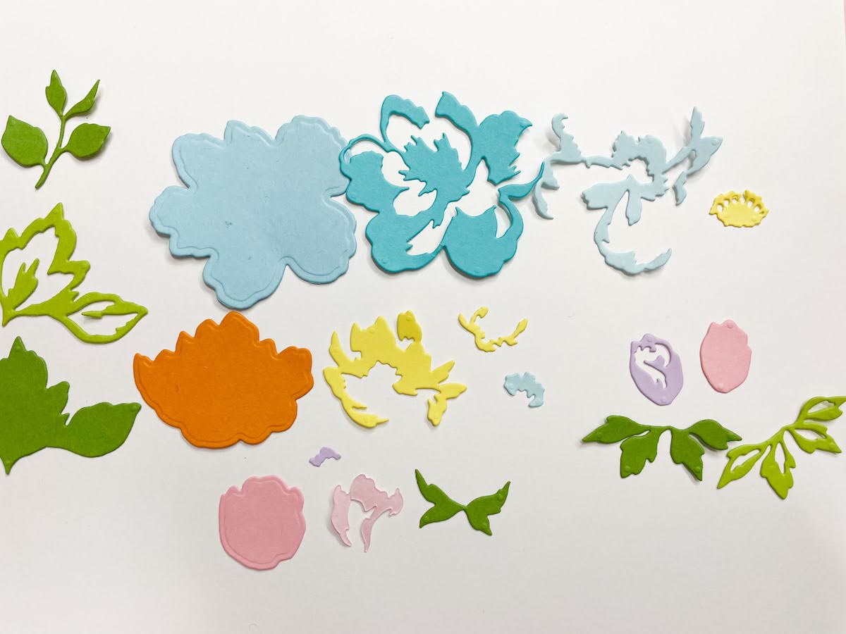 die cut layered flower pieces cut from Cardstock Warehouse paper