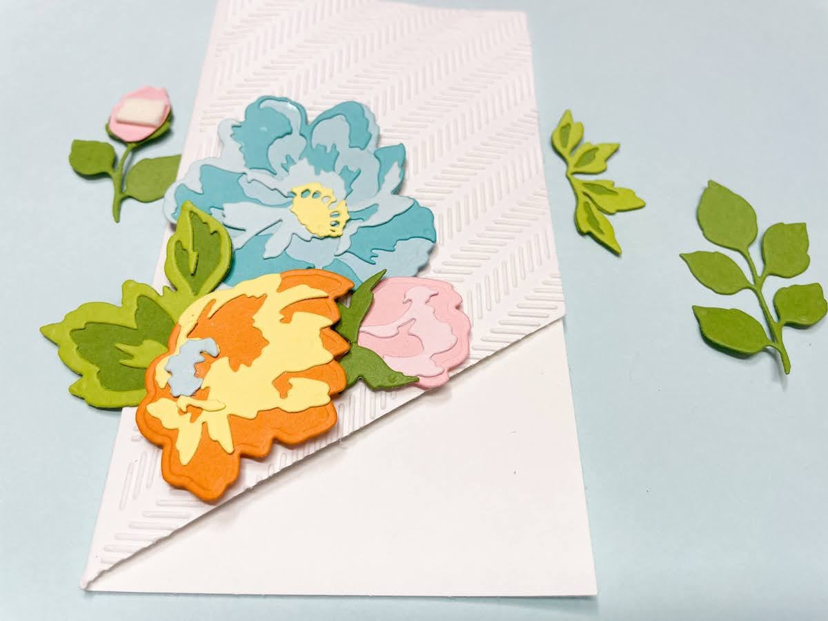 positioning flowers on card base