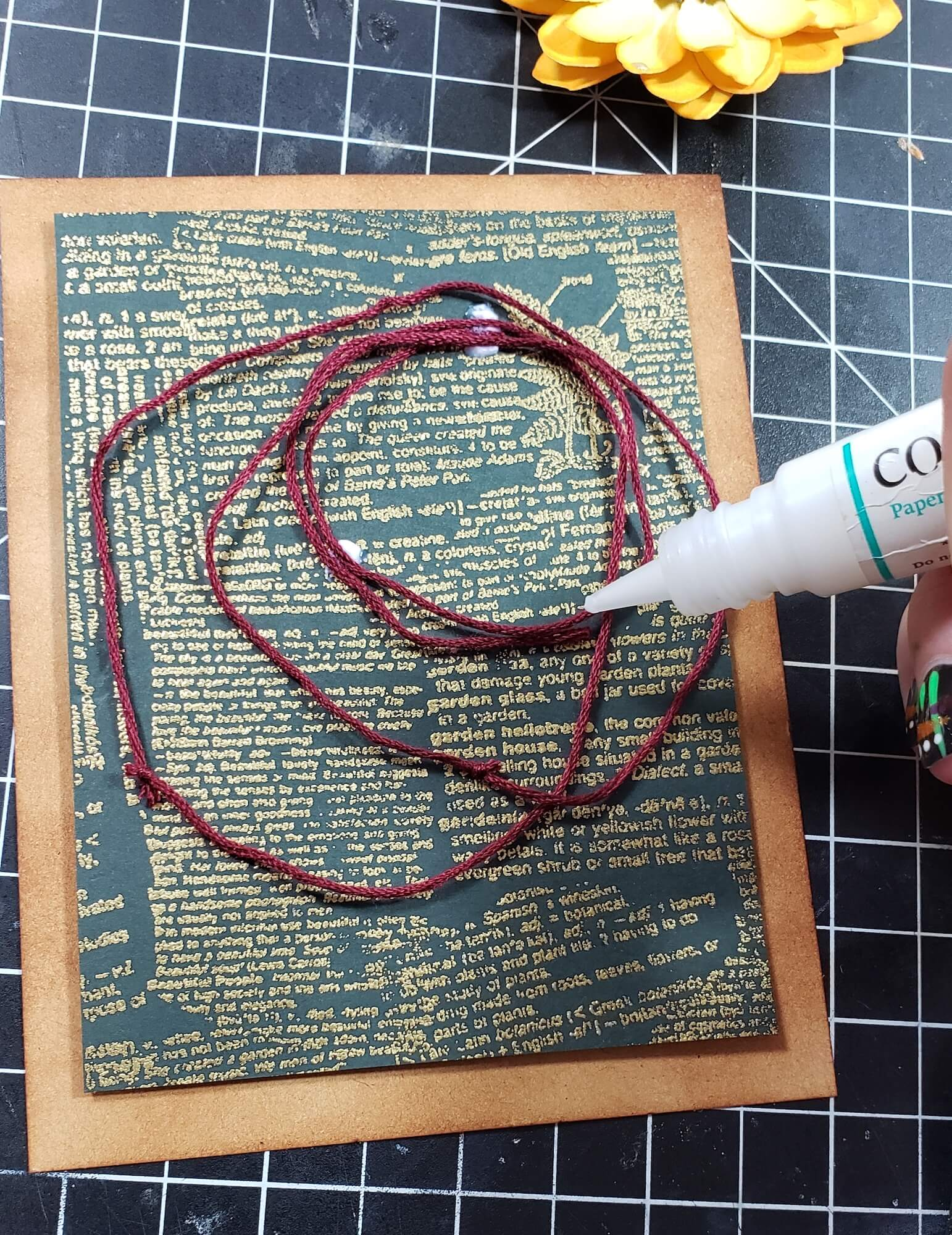 gluing on string accent to card background