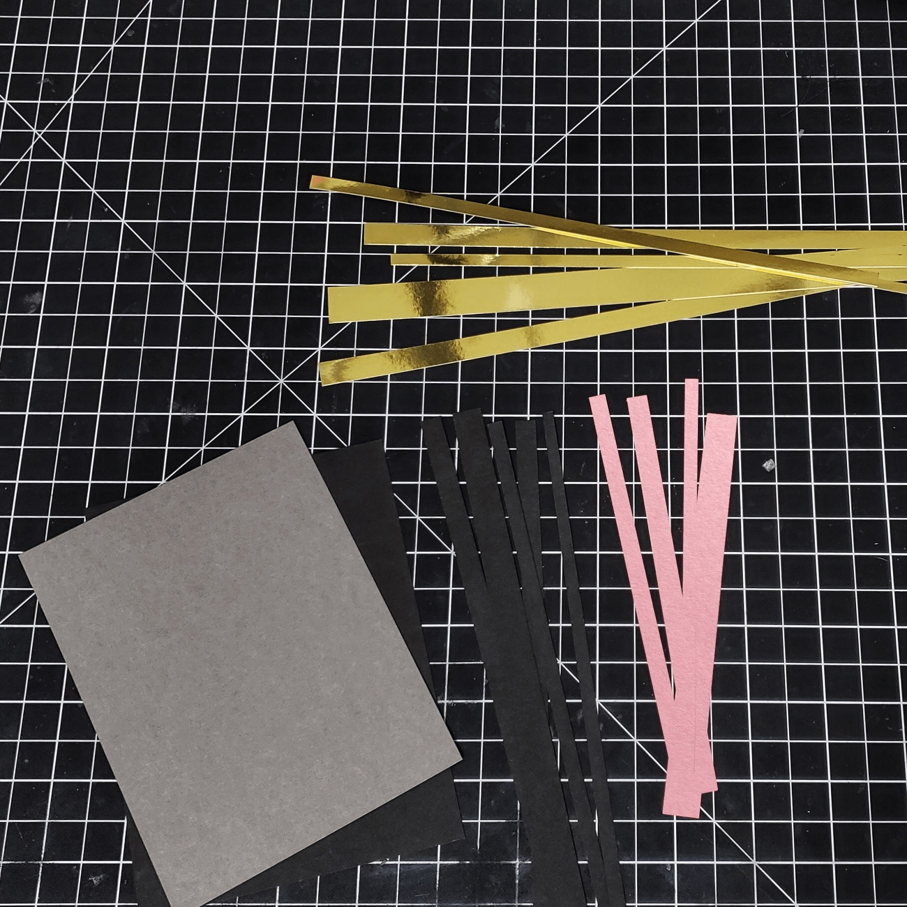 cutting strips of paper for textured background card