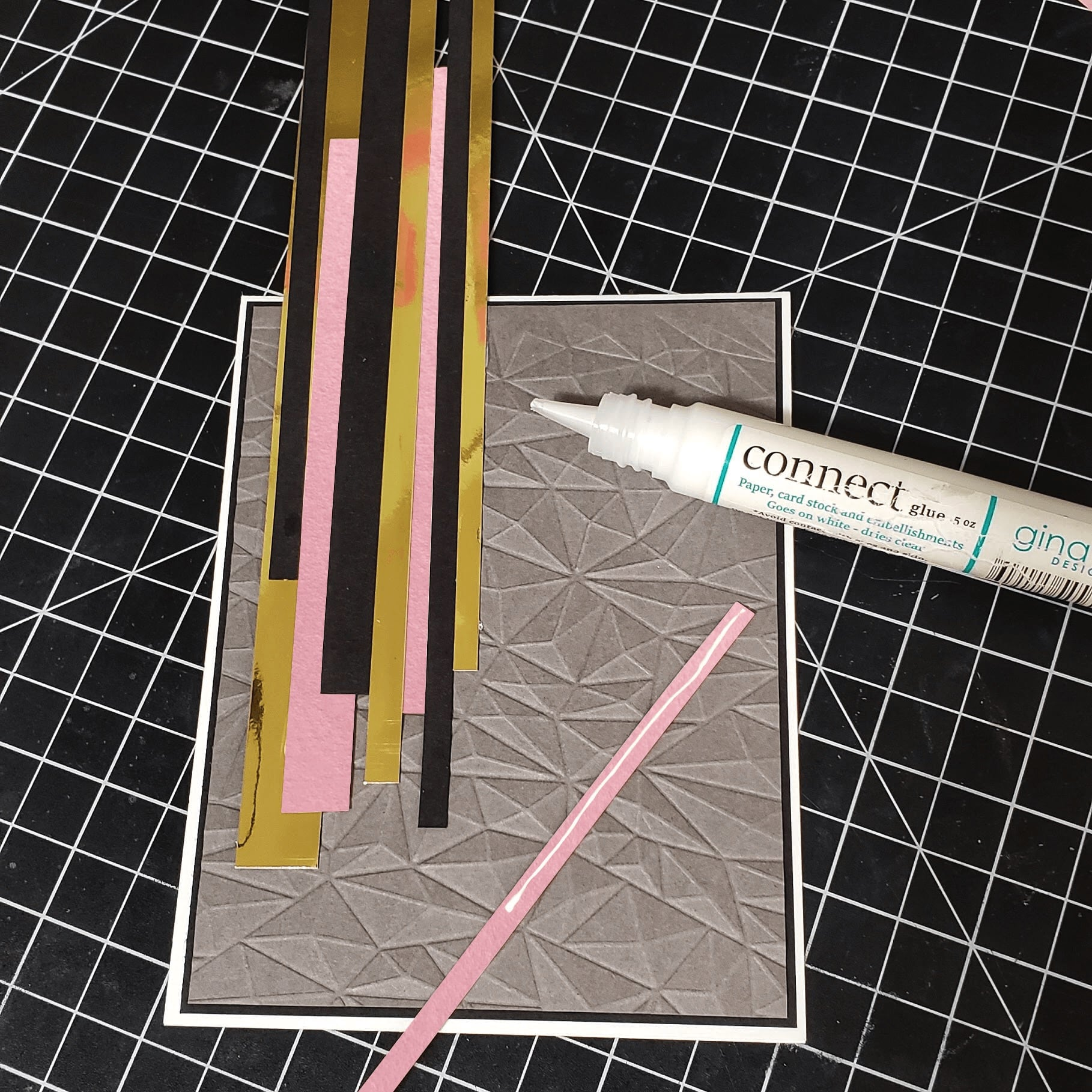 gluing paper strips to textured background card