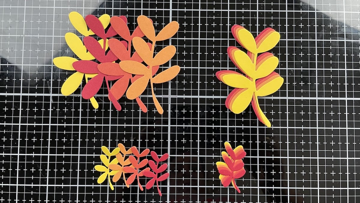 die-cut red, orange, and yellow autumn leaves