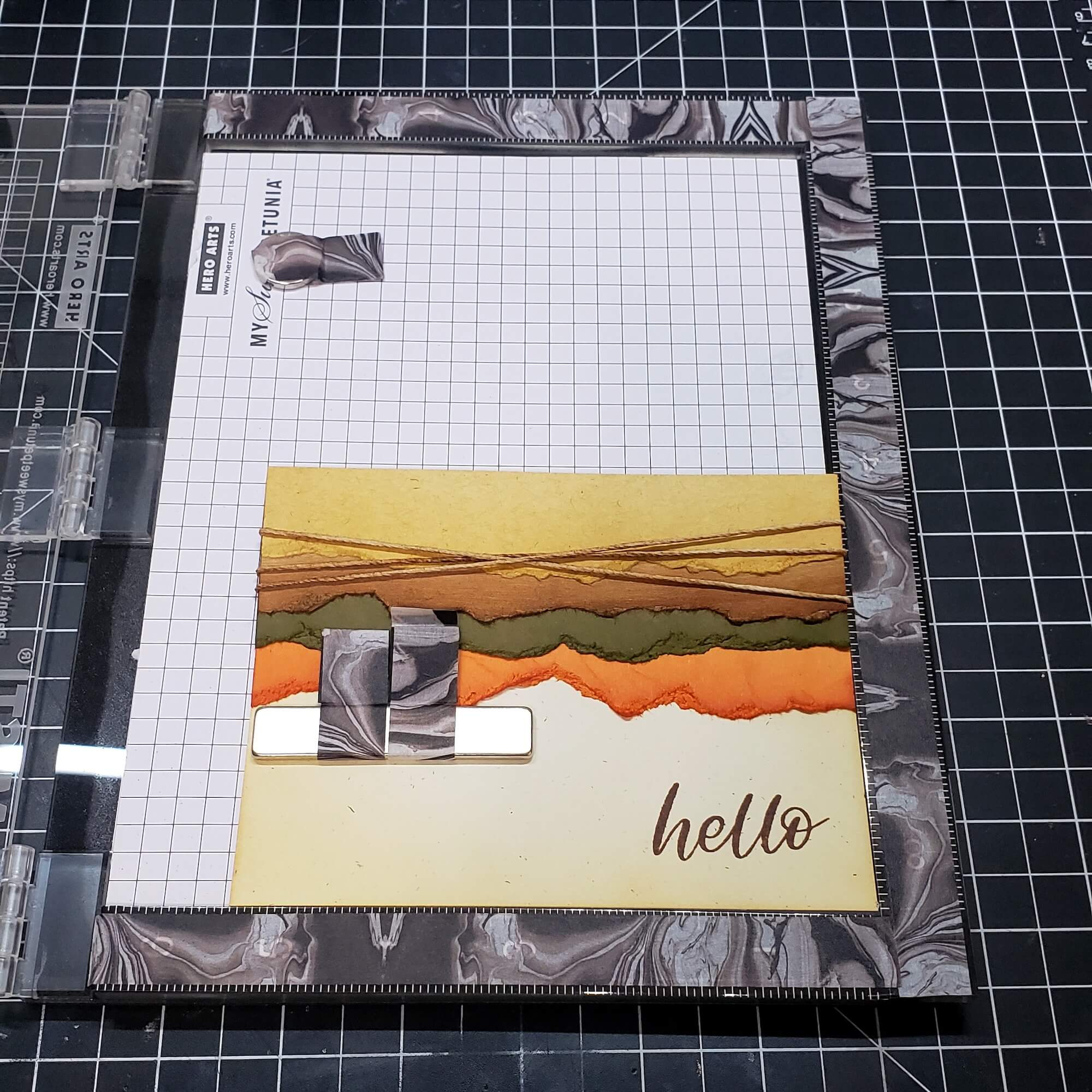 adding embellishments and stamps to card front