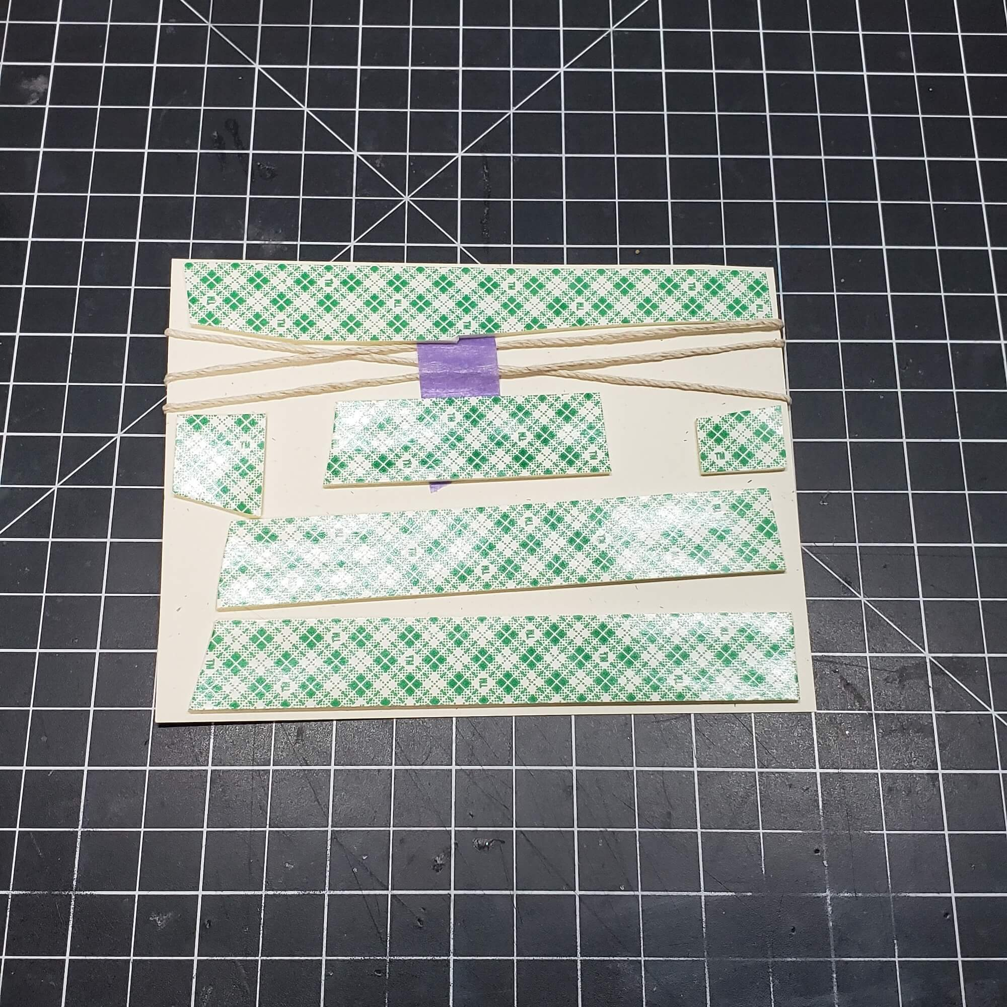 attaching twine and foam tape to back of card panel