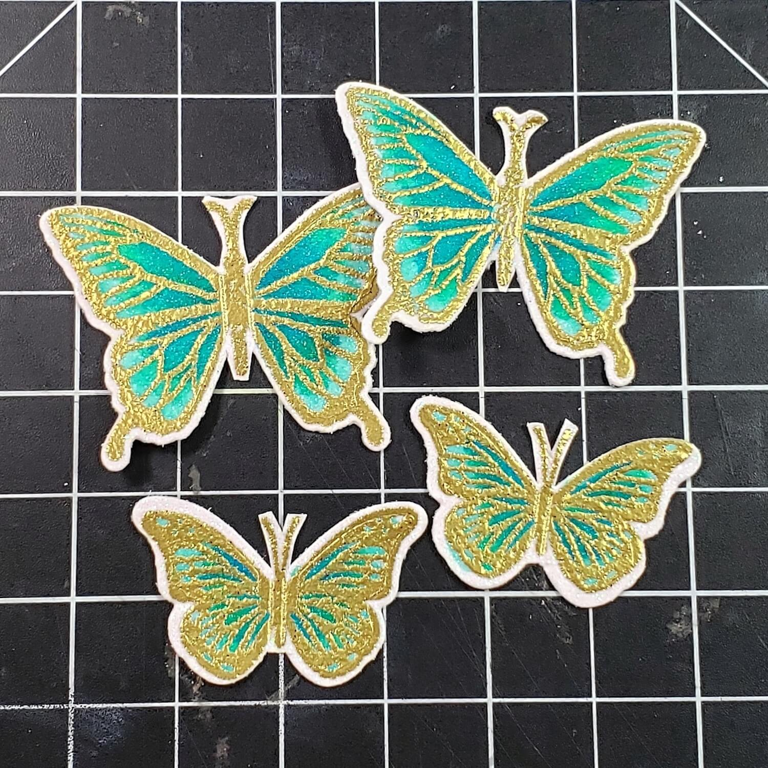 Stamped, embossed, and colored butterflies