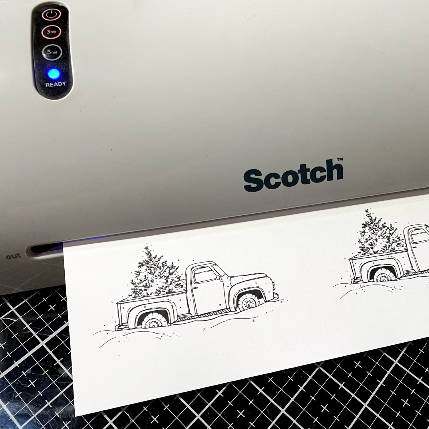 heat setting printed image with a laminator to prepare for coloring
