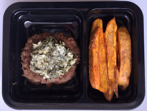 Grass Fed Beef Burger topped with Spinach and Artichoke and Sweet Potato Wedges
