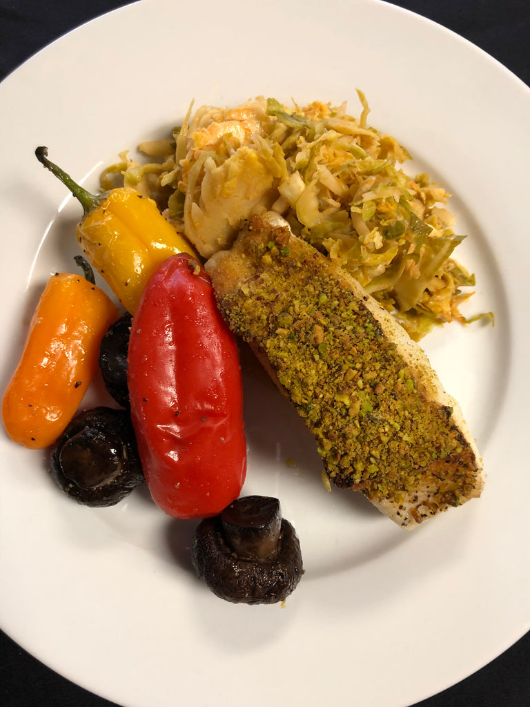 Pistachio Crusted Sea Bass over Sriracha Brussels sprouts and a side of Roasted Peppers and Mushrooms