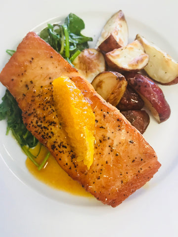 Orange Agave Glazed Salmon Over Sautéed Arugula with Roasted Potatoes