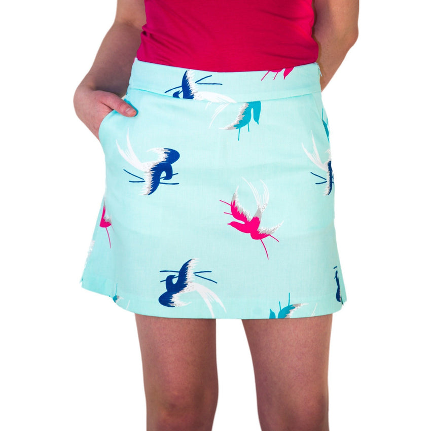 "Short skort teal with blue & pink sparrows - ""Madeline"" front view - Haute Shot Golf"