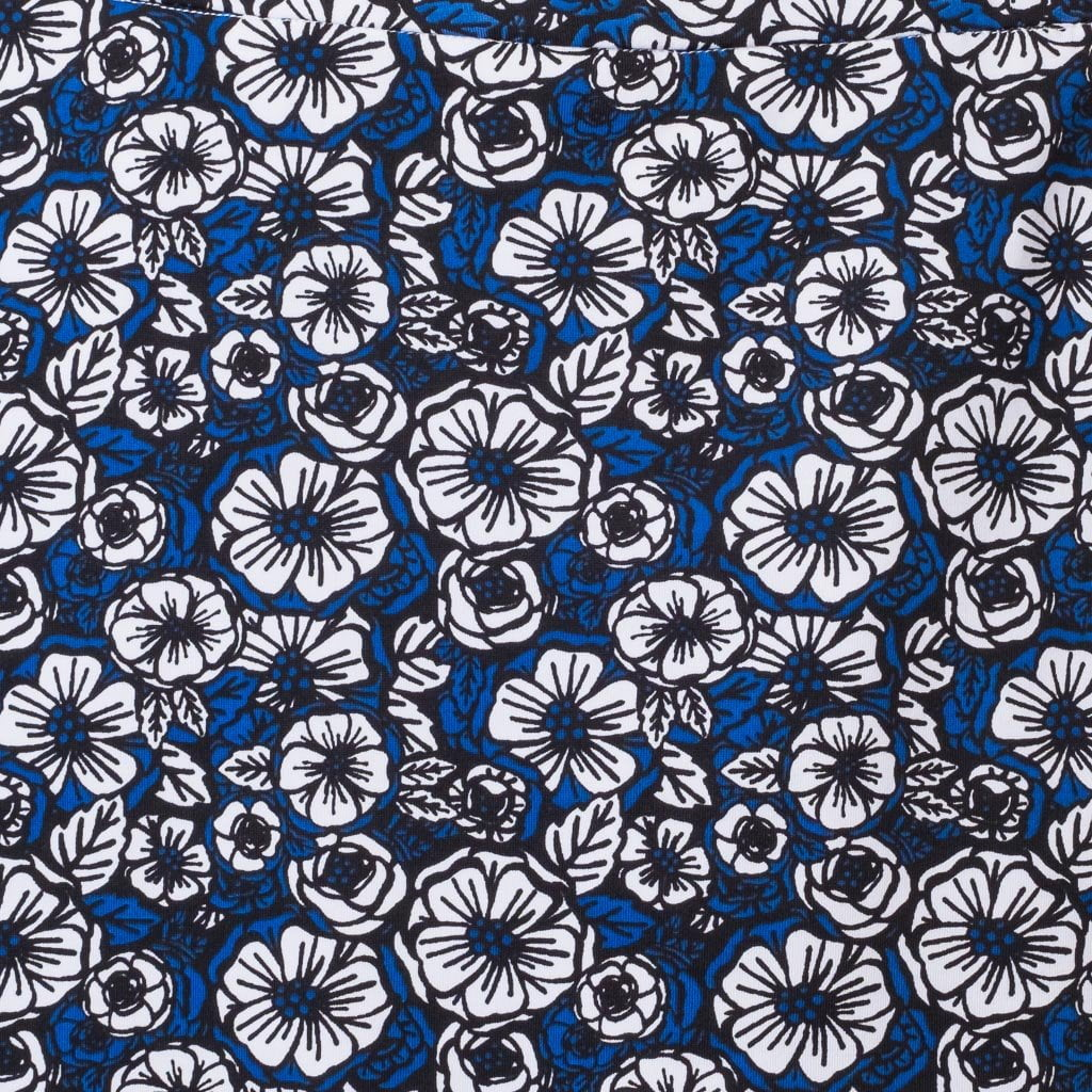 "Haute Shot Golf Ladies, ""Scarlett O'Hara"" Skort. Fabric swatch. Bold black, white and deep blue floral print in a micro-polyester blend."
