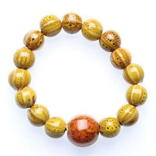 """Circle of Life"" Yellow Ceramic Bead Bracelet"