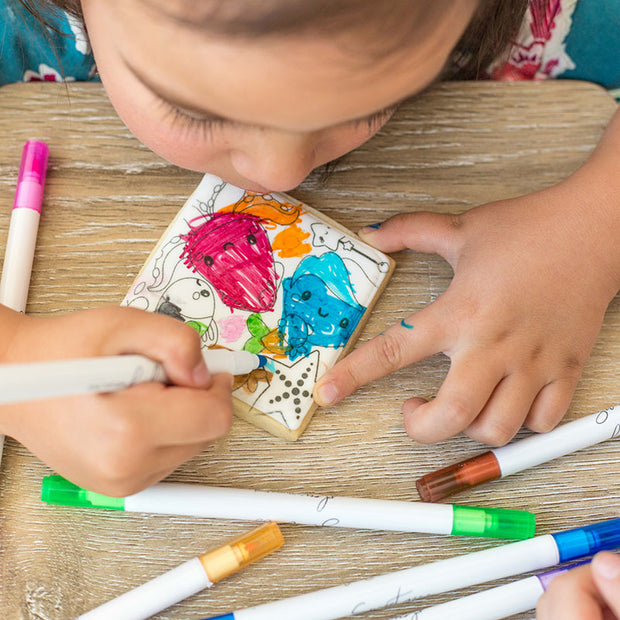 Child colouring cookie with edible ink marker