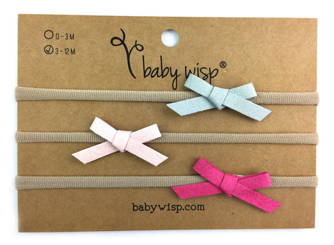 hand tied faux suede bows