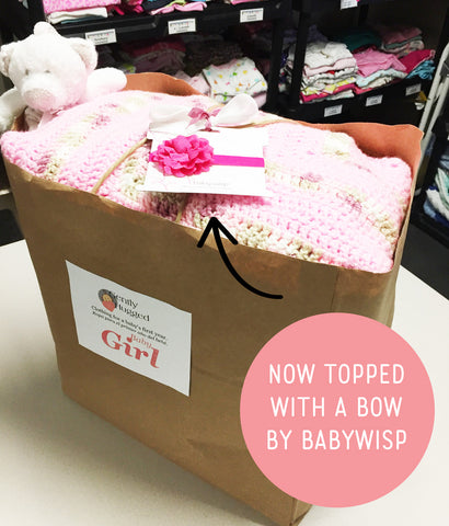 gently hugged bag topped with baby wisp bow