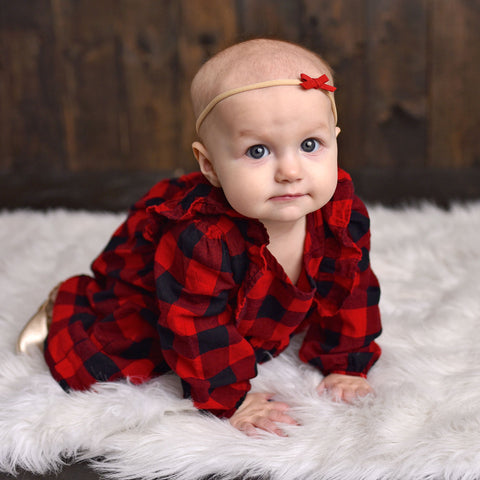 Cute baby girl wearing hand tied bow