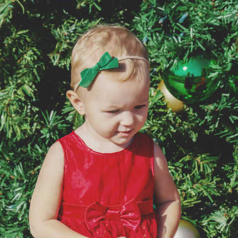 toddler wearing velvet bow