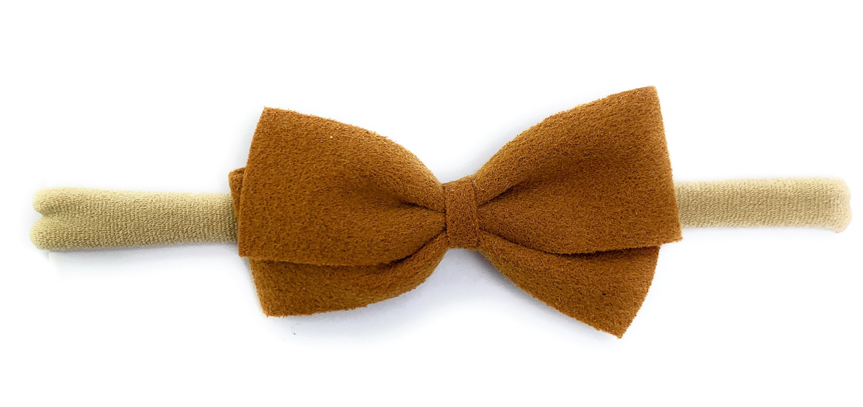 Faux suede bow on nylon headband a sweet and simple baby girls bow