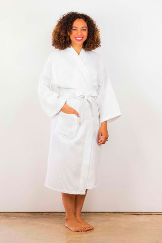Woman wearing a long white robe.