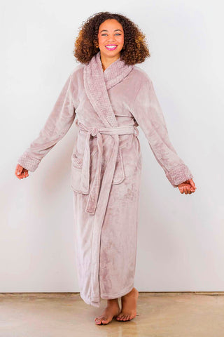 Woman wearing a blush / dusty rose ladies' microfleece plush robe.
