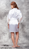 White satin robe with lace trim details.