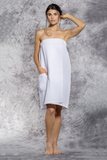 A woman wears a white bath wrap.