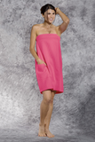 A woman wears a pink bath wrap.