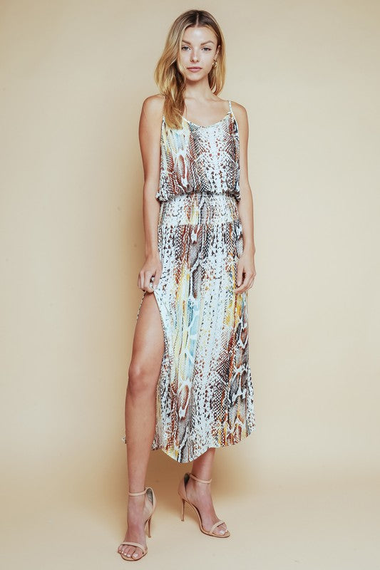 Olivaceous snake print midi dress with spaghetti straps and smocked waist band made from a silky rayon