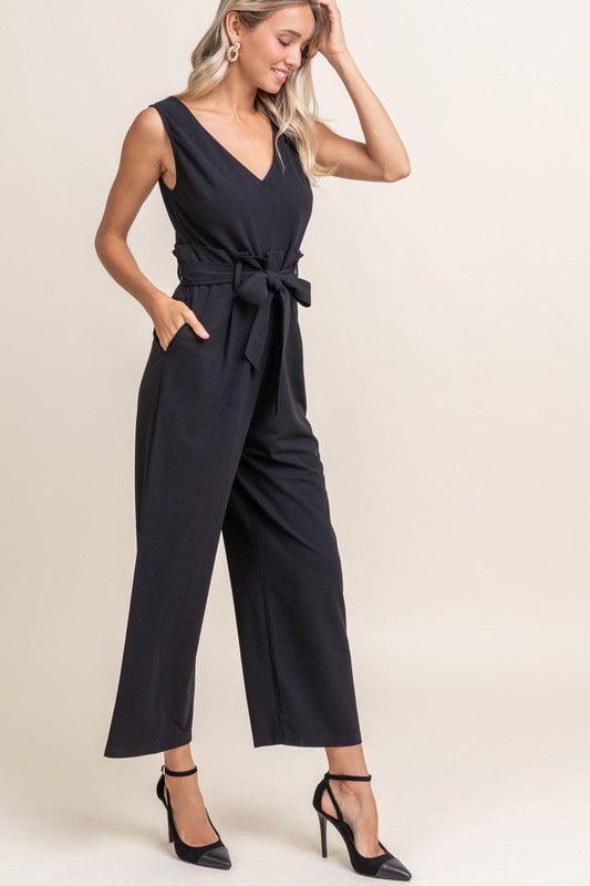 "Description Woven Jumpsuit Woven Jumpsuit Sleeveless V-Neckline Tie Belt Front with Paperbag Waistband Cut-out detail at back Back Zipper Closure Wide Leg Pockets Semi-Relazed Fit Unlined, Not Sheer Measurements Size S: Length measures 53"" from shoulder to hem, bust measures 34"" Size M: Length measures 54"" from shoulde…"