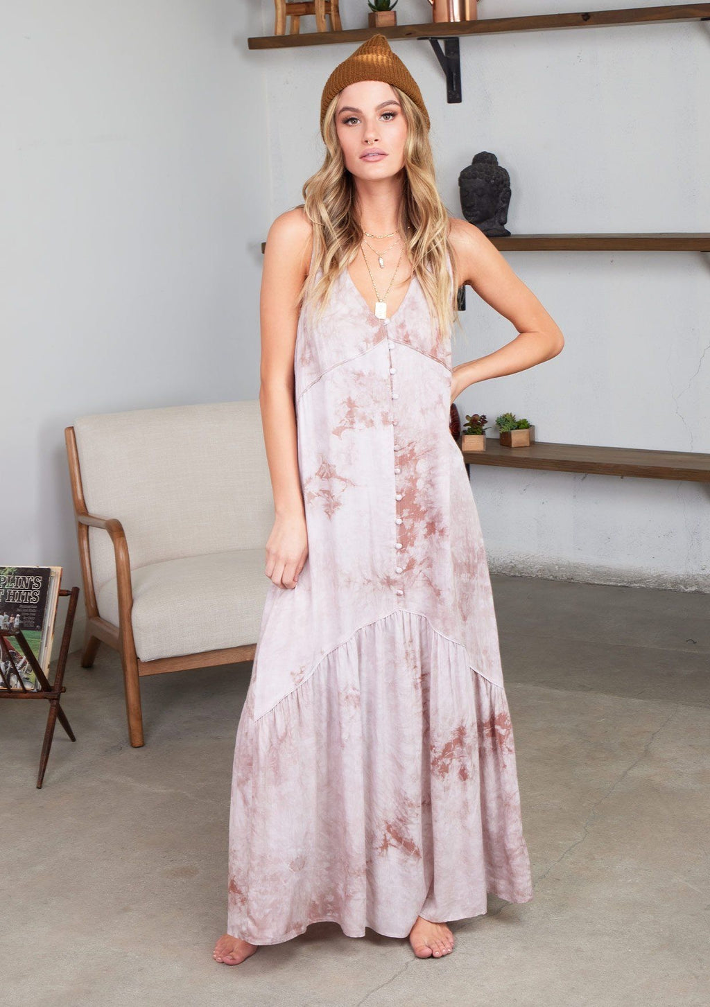 Description Maxi Length  Sleeveless Tiered Shirt V-Neck Button Front Variations in the Tie-Dye Print Unlined  Color:  Sand