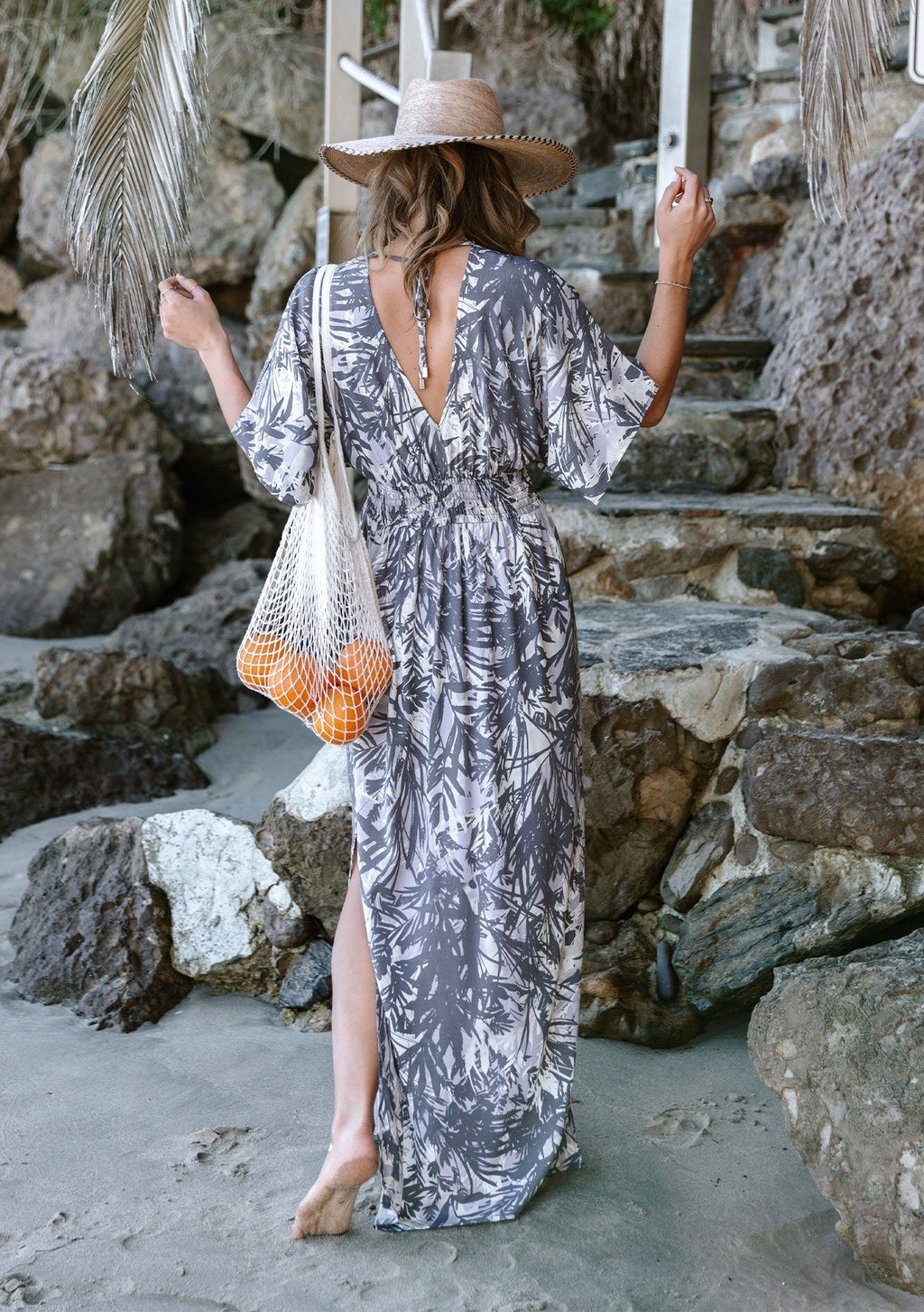 Maxi Dress with Kimono sleeves and Side Slits Short Kimono Sleeves V-Neckline Front and Back Open Tie Back Detail Smocked Elastic Empire Waist Relaxed Fit Unlined  Color:  Charcoal/White/Lavender